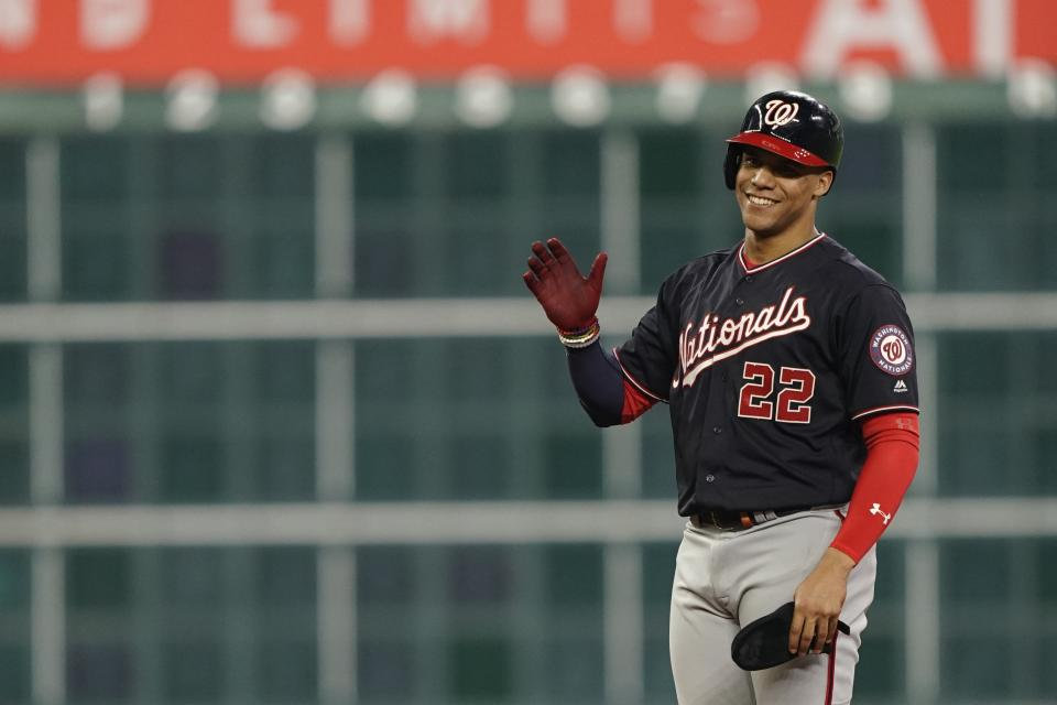 Washington Nationals' Juan Soto reacts after hitting a two-run scoring double during the fifth inning of Game 1 of the baseball World Series against the Houston Astros Tuesday, Oct. 22, 2019, in Houston. (AP Photo/David J. Phillip)