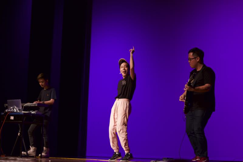 Singaporean queer bisexual pop singer-songwriter musician, Leon Markcus (centre), performing with his band. (Photo: Courtesy of Leon Markcus)