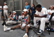 Nyjah Huston, center, waits with the rest of his teammates to be introduced at a news conference in downtown Los Angeles on Monday, June 21, 2021. Huston and the rest of the first U.S. Olympic skateboarding team was introduced in Southern California on Monday where the sport was invented roughly 70 years ago. Skateboarding is an Olympic sport for the first time in Tokyo, and the Americans are expected to be a strong team. (AP Photo/Richard Vogel)
