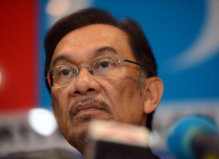 """Opposition leader Anwar Ibrahim holds a press conference at his party head office in Petaling Jaya on May 7, 2013. Malaysian police have declared illegal a rally planned for Wednesday night by the opposition leader to protest against election results that he says were """"stolen"""" through massive fraud"""
