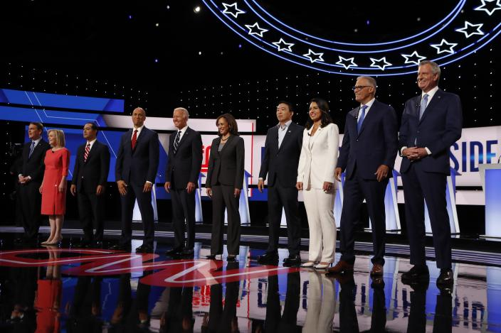 Democratic candidates are introduced before a Democratic debate in Detroit on Wednesday. (AP Photo/Carlos Osorio)