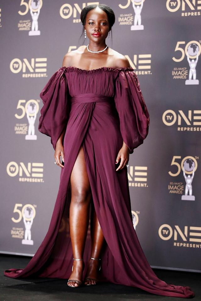 Here we have <strong>Lupita Nyong'o</strong> in a style maybe best known as hot French peasant wench. Puffy sleeves, off-the-shoulder, hair in milkmaid braids—appropriate for a red carpet and milking the cows. Very now, very 2019.