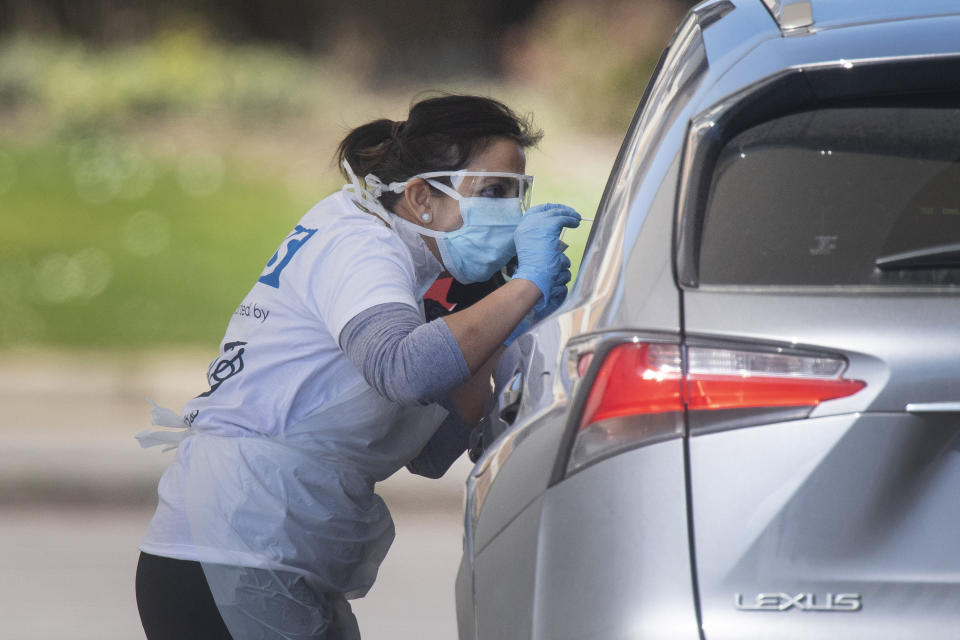 Photo taken at 12.31 shows tests being carried out at a coronavirus testing site in a car park at Chessington World of Adventures, in Greater London, as the UK continues in lockdown to help curb the spread of the coronavirus.