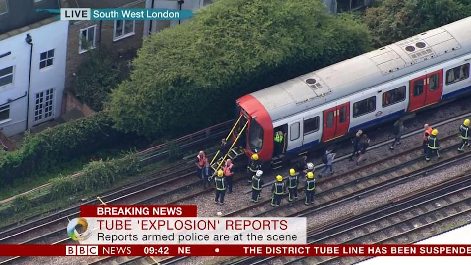 <p>Fire crews carefully investigate the Tube carriage where the blast took place. (PA/BBC News) </p>