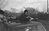 <p>Bob Dylan on the top of a car in Massachusetts, April 1964.</p>