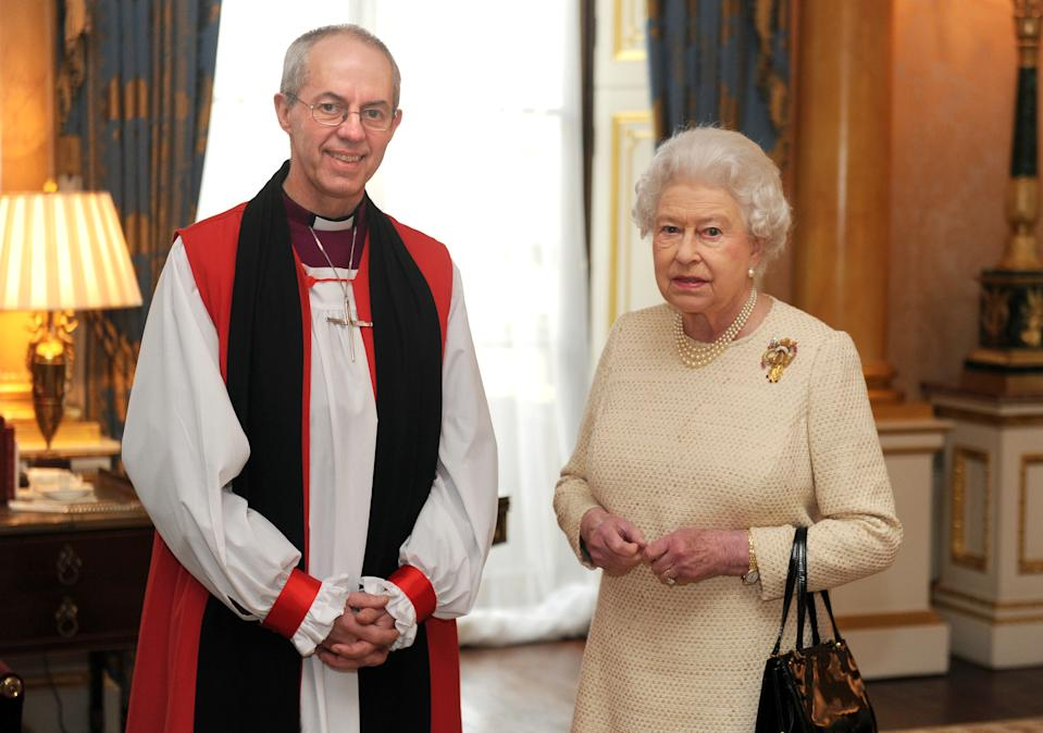 Britain's Queen Elizabeth II (R) receives new Archbishop of Canterbury Justin Welby (L) at Buckingham Palace in central London on February 26, 2013 after his act of 'Homage' to the Queen, one of the formal stages of his appointment before he begins his public ministry. The new Archbishop of Canterbury Justin Welby, a former oil executive who has risen swiftly up the ranks of the Church of England, will be enthroned at Canterbury on March 21. AFP PHOTO / POOL / ANTHONY DEVLIN        (Photo credit should read Anthony Devlin/AFP via Getty Images)