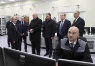 """Belarusian President Alexander Lukashenko, centre, attends the first Belarusian Nuclear Power Plant during the plant's power launch event outside the city of Astravets, Belarus, Saturday, Nov. 7, 2020. Alexander Lukashenko on Saturday formally opened the country's first nuclear power plant, a project sharply criticized by neighboring Lithuania. Lukashenko said the launch of the Russian-built and -financed Astravyets plant """"will serve as an impetus for attracting the most advanced technologies to the country. and innovative directions in science and education."""" (Nikolai Petrov/BelTA Pool Photo via AP)"""
