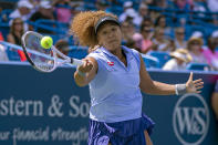 FILE - Naomi Osaka, of Japan, hits the ball to Cori Gauff during the Western & Southern Open tennis tournament in Mason, Ohio, in this Wednesday, Aug. 18, 2021, file photo. Osaka is seeded for the U.S. Open, the year's last Grand Slam tennis tournament. Play in the main draw begins in New York on Monday, Aug. 30. (Cara Owsley/The Cincinnati Enquirer via AP, File)