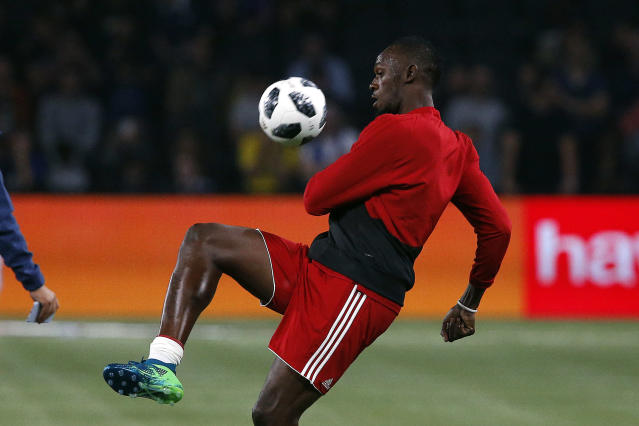 """<a class=""""link rapid-noclick-resp"""" href=""""/olympics/rio-2016/a/1056797/"""" data-ylk=""""slk:Usain Bolt"""">Usain Bolt</a>, seen here prepping for a June charity soccer match in France, hopes to have a second act as a professional soccer player. (AP)"""