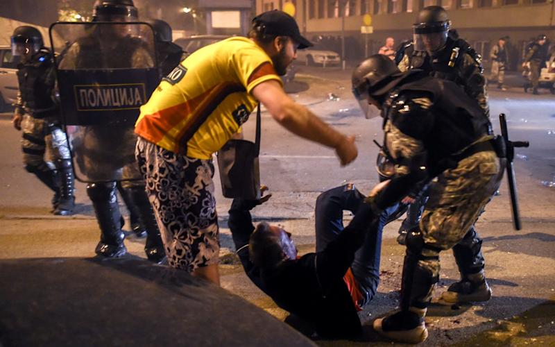 Protesters clash with police in Skopje - Credit: EPA
