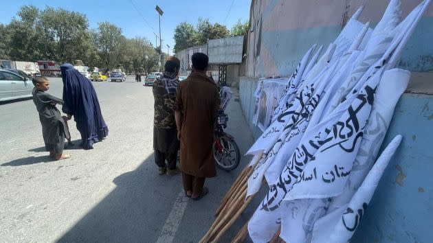 KABUL, AFGHANISTAN - AUGUST 26:  Flags of Taliban distributed  to people near the evacuated US Embassy in Kabul, Afghanistan, on August 26, 2021. (Photo by Haroon Sabawoon/Anadolu Agency via Getty Images) (Photo: Anadolu Agency via Getty Images)