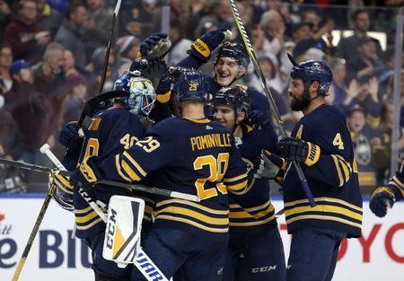 Nov 10, 2018; Buffalo, NY, USA; Buffalo Sabres right wing Jason Pominville (29) celebrates a win with teammates against the Vancouver Canucks at KeyBank Center. Mandatory Credit: Timothy T. Ludwig-USA TODAY Sports