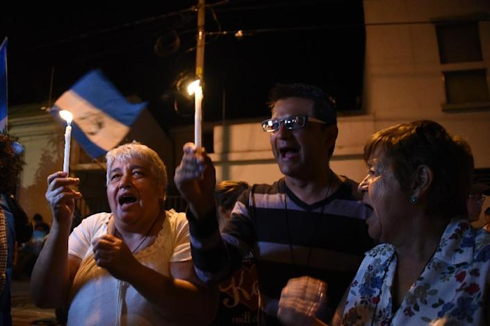 People take part in a demonstration demanding the resignation of Guatemalan President Otto Perez on August 23, 2015, in Guatemala City (AFP Photo/Johan Ordonez)