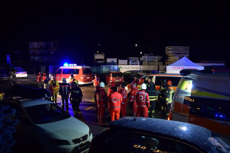 Ambulance and fire crews work at the scene where a male driver of a car hit a group of German tourists, killing six in Lutago