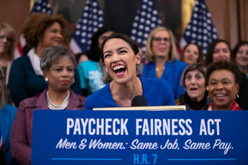 Rep. Alexandria Ocasio-Cortez, D-N.Y., smiles as she speaks at an event to advocate for the Paycheck Fairness Act on the 10th anniversary of President Barack Obama signing the Lilly Ledbetter Fair Pay Act, at the Capitol in Washington, Wednesday, Jan. 30, 2019. The legislation, a top tier issue for the new Democratic majority in the House, would strengthen the Equal Pay Act of 1963 and guarantee that women can challenge pay discrimination and hold employers accountable.(AP Photo/J. Scott Applewhite)