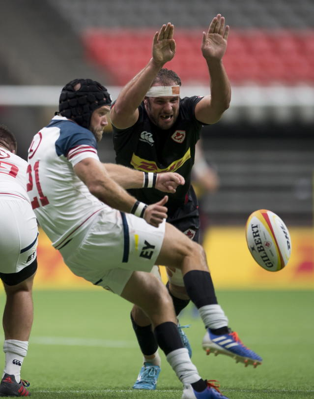 Canada's Tyler Ardon tries to block United States' Malon Al-Jiboori's kick during the second half of a rugby match in Vancouver, British Columbia, Saturday, Sept. 7, 2019. (Jonathan Hayward/The Canadian Press via AP)
