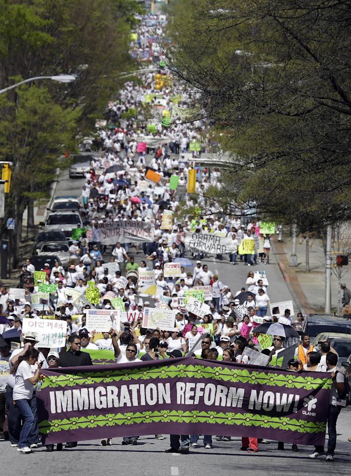 Protesters for immigration reform march near the Georgia Capitol Wednesday, April 10, 2013, in Atlanta. More than 1,000 people rallied at the Georgia Capitol and marched through downtown Atlanta to express support for comprehensive immigration reform and to call for an end to deportations. (AP Photo/John Bazemore)