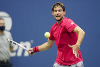 Dominic Thiem, of Austria, returns a shot to Alexander Zverev, of Germany, during the men's singles final of the US Open tennis championships, Sunday, Sept. 13, 2020, in New York. (AP Photo/Frank Franklin II)
