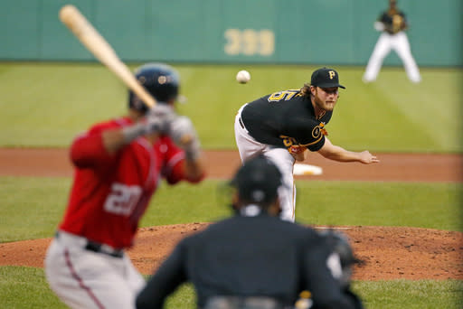Pittsburgh Pirates starting pitcher Gerrit Cole, top, delivers a pitch to Washington Nationals' Ian Desmond (20) in the fourth inning of a baseball game in Pittsburgh, Saturday, May 24, 2014. Desmond deposited the pitch in the left field stands for a solo home run. (AP Photo/Gene J. Puskar)