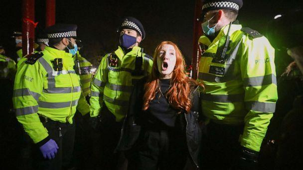 PHOTO: Police detain a woman as people gather at a memorial site in Clapham Common Bandstand, following the kidnap and murder of Sarah Everard, in London, on March 13, 2021. (Hannah Mckay/Reuters)
