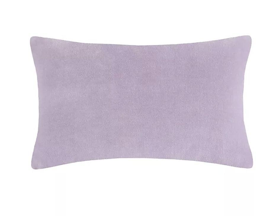 <p>The easiest way to add lavender to a room is with a <span>Kate Spade Falling Flowers Oblong Throw Pillow</span> ($50).</p>