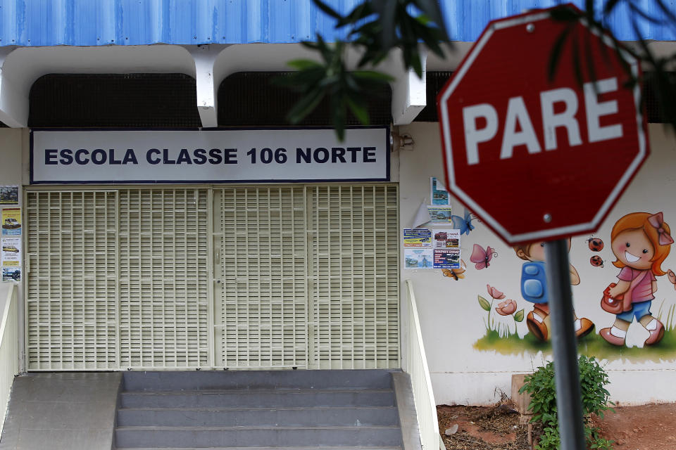 The Escola Classe 106 Norte public school in the Asa Norte neighborhood sits closed, in Brasilia, Brazil, Thursday, March 12, 2020. Gov. Ibaneis Rocha announced the suspension of classes as a precaution against the spread of the new coronavirus. For most people, the new coronavirus causes only mild or moderate symptoms, such as fever and cough. For some, especially older adults and people with existing health problems, it can cause more severe illness, including pneumonia.  (AP Photo/Beto Barata)