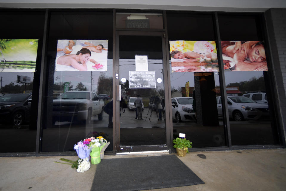 A make-shift memorial is seen outside a business where a multiple fatal shooting occurred on Tuesday, Wednesday, March 17, 2021, in Acworth, Ga. Robert Aaron Long, a white man, is accused of killing several people, most of whom were of Asian descent, at massage parlors in the Atlanta area. (AP Photo/Mike Stewart)