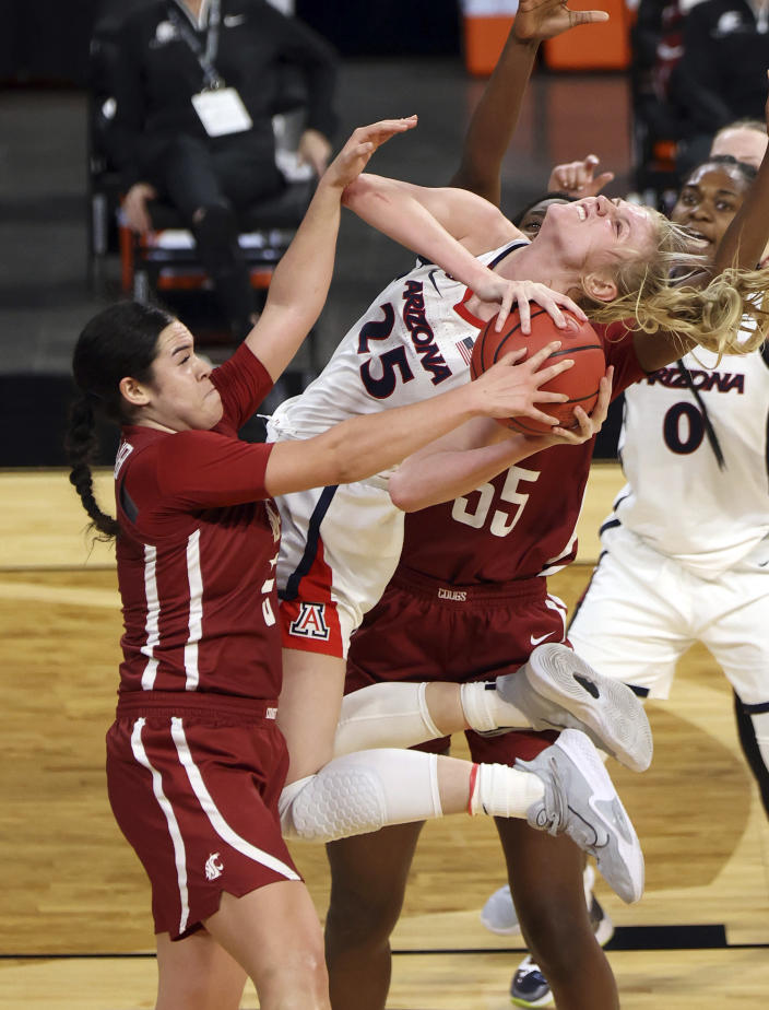 Arizona forward Cate Reese (25) shoots as Washington State guard Charlisse Leger-Walker (5) defends during the first half of an NCAA college basketball game in the second round of the Pac-12 women's tournament Thursday, March 4, 2021, in Las Vegas. (AP Photo/Isaac Brekken)