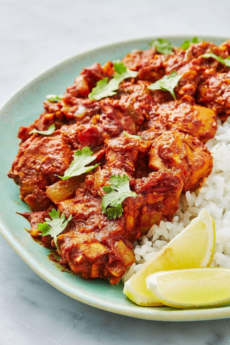 """<p>We love this easy, healthy chicken bhuna recipe, a sure-fire dinner table win - the ultimate crowd pleaser. </p><p>Get the <a href=""""https://www.delish.com/uk/cooking/recipes/a28867202/chicken-bhuna/"""" rel=""""nofollow noopener"""" target=""""_blank"""" data-ylk=""""slk:Chicken Bhuna"""" class=""""link rapid-noclick-resp"""">Chicken Bhuna</a> recipe.</p>"""