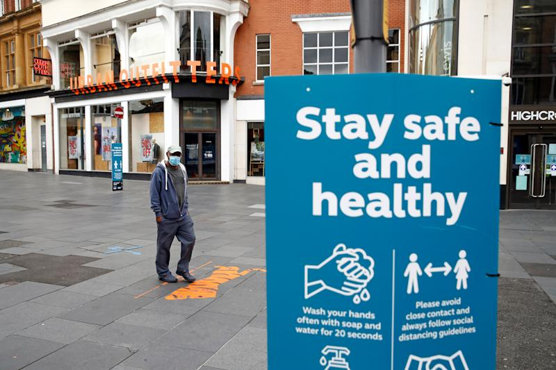 A sign is pictured at an almost empty street, following a local lockdown imposed amid the coronavirus disease (COVID-19) outbreak, in Leicester, Britain, July 4, 2020. REUTERS/Jason Cairnduff