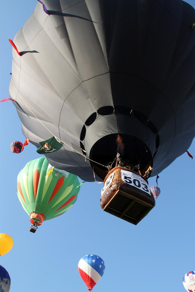 Pilot and deputy director of the America's Challenge gas balloon race Kevin Knapp lifts off in the Wounded Warrior Project balloon #503 at the Albuquerque International Balloon Fiesta in Albuquerque, N.M., on Saturday, Oct. 2, 2010.