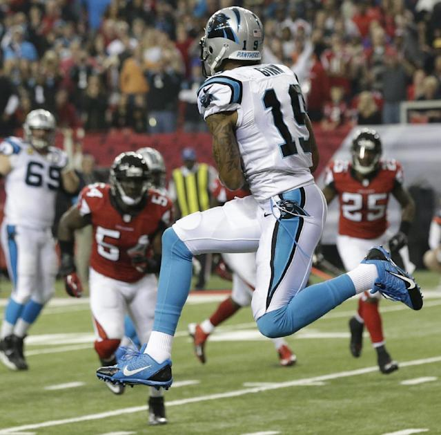 Carolina Panthers wide receiver Ted Ginn (19) makes a touch-down catch against the Atlanta Falcons during the first half of an NFL football game, Sunday, Dec. 29, 2013, in Atlanta. (AP Photo/John Bazemore)