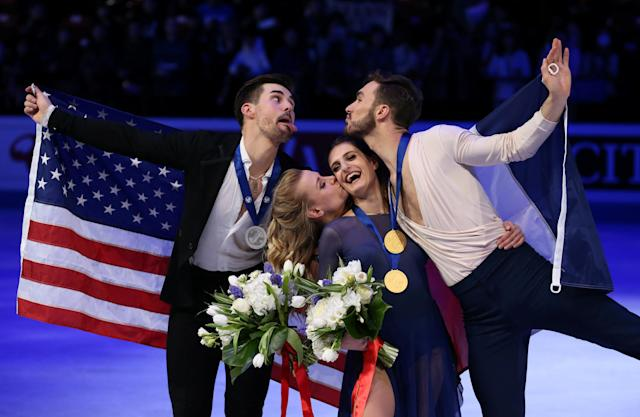 Figure Skating - World Figure Skating Championships - The Mediolanum Forum, Milan, Italy - March 24, 2018 France's Gabriella Papadakis and Guillaume Cizeron pose after winning the gold medal in the Ice Dance with second placed Madison Hubbell and Zachary Donohue of the U.S. REUTERS/Alessandro Bianchi