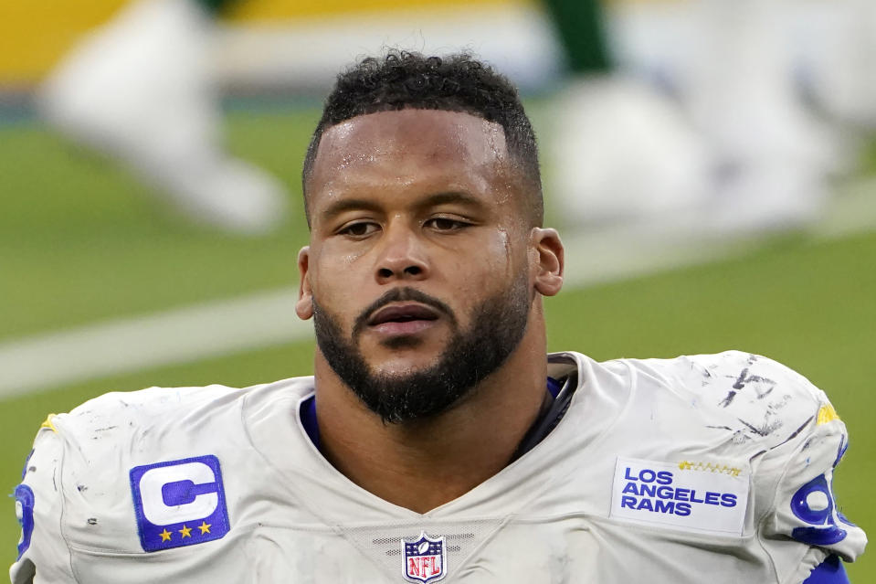 FILE - Los Angeles Rams defensive end Aaron Donald (99) walks off the field after a loss to the New York Jets in an NFL football game in Inglewood, Calif., in this Sunday, Dec. 20, 2020, file photo. A lawyer and his 26-year-old client told Pittsburgh police Wednesday, April 14, 2021, that Los Angeles Rams defensive lineman Aaron Donald and others assaulted the man at a nightclub last weekend, causing multiple injuries. (AP Photo/Jae C. Hong, File)
