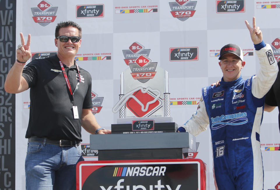 FILE - In this Saturday, June 5, 2021, file photo, car owner Matt Kaulig, left, celebrates with A.J. Allmendinger in Victory Lane after winning the NASCAR Xfinity Series auto race at Mid-Ohio Sports Car Course in Lexington, Ohio. Kaulig Racing has purchased two charters from Spire Motorsports and will move to NASCAR's Cup Series next year with a full-time ride for Justin Haley and select races for AJ Allmendinger. (AP Photo/Tom E. Puskar)