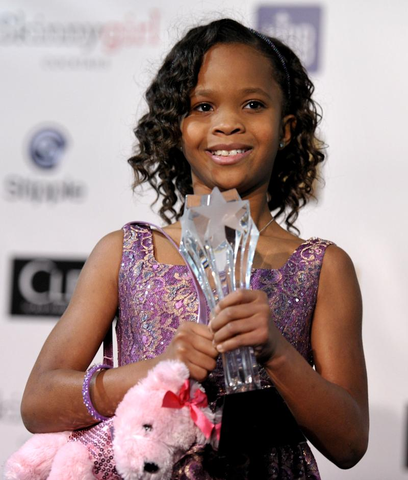 """FILE - In this Jan. 10, 2013 file photo, Quvenzhane Wallis is seen backstage with her award for best young actress for """"Beasts of the Southern Wild,"""" at the 18th Annual Critics' Choice Movie Awards at the Barker Hangar in Santa Monica, Calif. Wallis is an actress of talent, poise and maturity well beyond her years. She was 6 when she played the part of Hushpuppy, and at only 9, she is the youngest-ever best actress nominee at the Academy Awards. (Photo by John Shearer/Invision/AP, File)"""