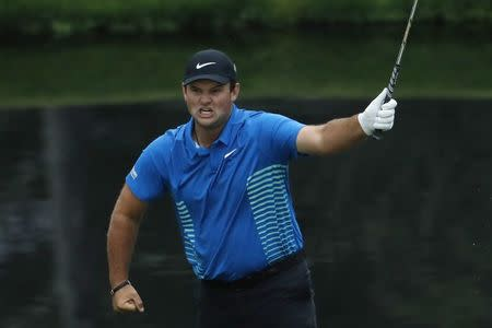 While others fall, Patrick Reed rises to take Masters lead