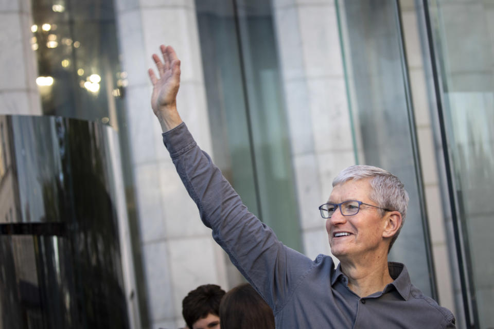 Apple CEO Tim Cook waves to customers before they enter Apple's flagship 5th Avenue store to purchase the new iPhone 11 on 20 September in New York City. Photo: Drew Angerer/Getty
