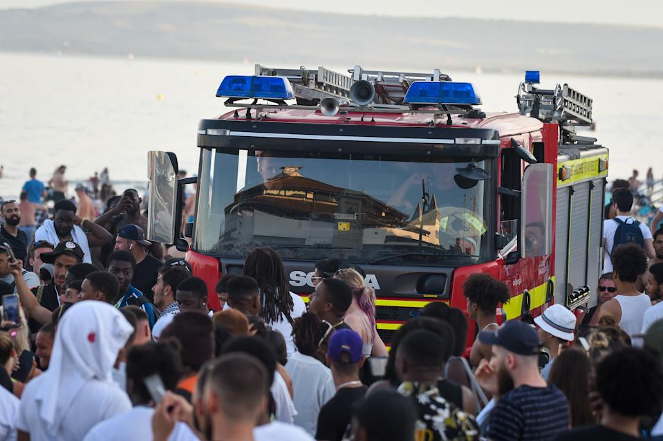 BOURNEMOUTH, ENGLAND - JUNE 25: A fire engine struggles through the crowds on the promenade on June 25, 2020 in Bournemouth, United Kingdom. A major incident was declared by the local council as thousands flocked to Bournemouth and the Dorset coast. The UK is experiencing a summer heatwave, with temperatures in many parts of the country expected to rise above 30C and weather warnings in place for thunderstorms at the end of the week. (Photo by Finnbarr Webster/Getty Images)