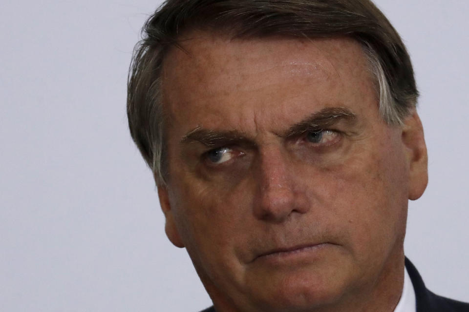 Brazil's President Jair Bolsonaro attends a ceremony to present the government's agenda to the newly elected mayors, at the Planalto Presidential Palace, in Brasilia, Brazil, Feb. 23, 2021. (AP Photo/Eraldo Peres)