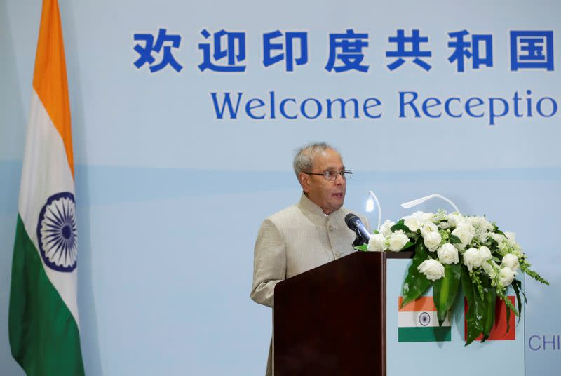 FILE PHOTO: India's President Pranab Mukherjee delivers a speech at a reception in Beijing