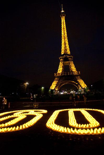 Earth Hour 2010. Candles forming 60 for Earth Hour near the Eiffel Tour, Paris, France.