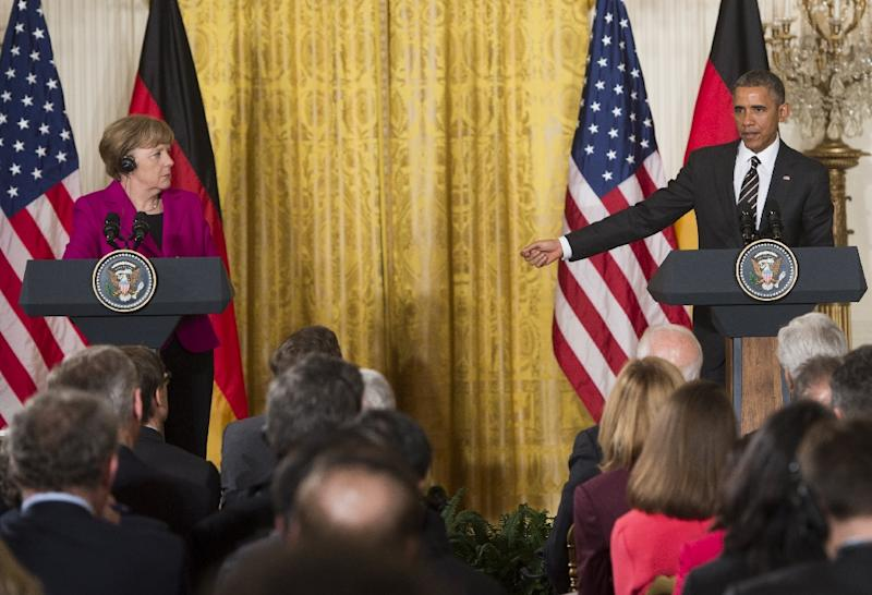 US President Barack Obama and German Chancellor Angela Merkel hold a joint press conference in the East Room of the White House in Washington, DC, February 9, 2015 (AFP Photo/Saul Loeb)