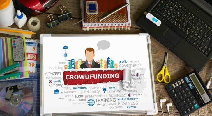 an image of the words crowdfunding on a tablet on a table