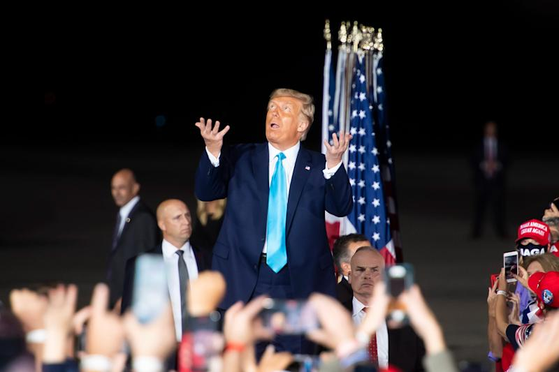 President Donald Trump reacts to the light rain as he arrives at a campaign rally at Avflight Harrisburg at the Harrisburg International Airport on Saturday, September 26, 2020, in Middletown, Pa.
