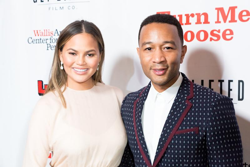 Chrissy Teigen, pictured with husband John Legend on Oct. 19, left one ginormous gratuity. (Greg Doherty via Getty Images)