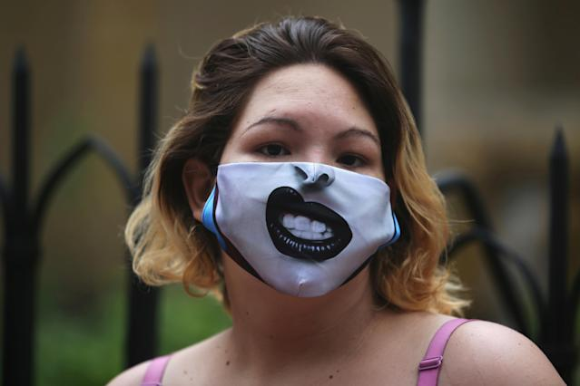 A woman wears a mask in Bogota, Colombia. (Reuters)