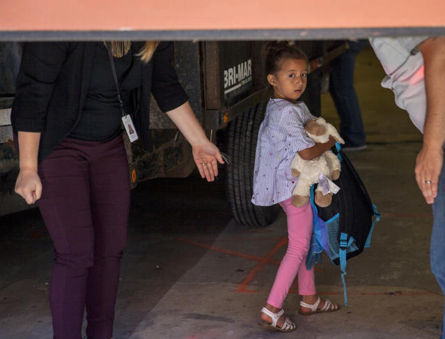 Children taken from their from parents are brought to the U.S. Immigration and Customs Enforcement (ICE) office building in Grand Rapids, Mich., to be reunited with family on Tuesday, July 10, 2018. More than 2,000 children were reportedly separated from their parents after crossing the Southern U.S. border as part of an immigration strategy by the Trump administration. (Cory Morse/The Grand Rapids Press via AP)