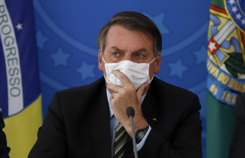 Brazilian President Jair Bolsonaro gestures using a face cover during a press conference regarding the COVID-19, coronavirus pandemic at the Planalto Palace, Brasilia on March 18, 2020. (Photo by Sergio LIMA / AFP) (Photo by SERGIO LIMA/AFP via Getty Images)