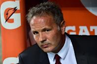 Sinisa Mihajlovic is asking both sides in the AC Milan-Inter Milan derby to make contributions to help the migrant crisis (AFP Photo/Giuseppe Cacace)